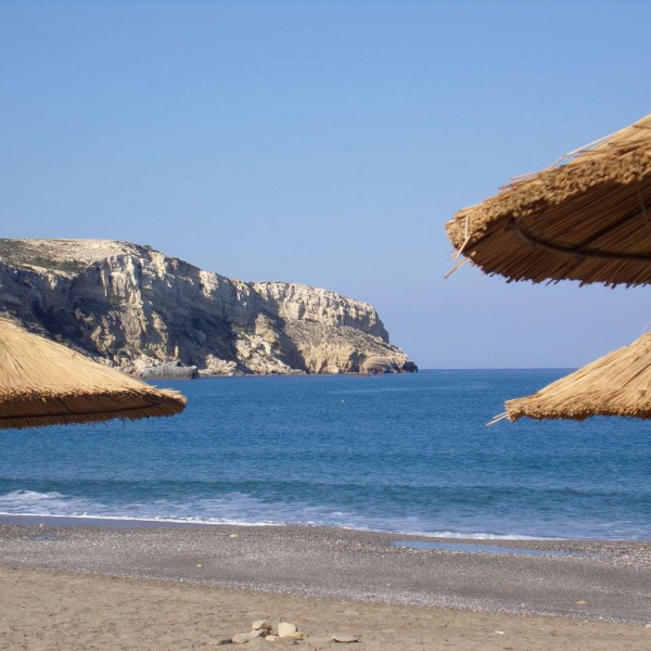 beach-umbrellas-at-beach-komos-odigitria-monastery-matala-south-heraklion-crete
